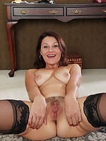 Hairy mature babe Ava Austin wearing only stockings.