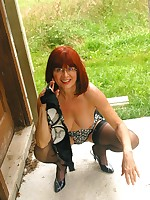 Mature lady outside in her panties