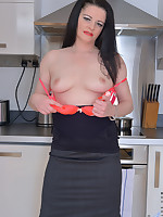 Raven haired housewife rubs her throbbing clit in the kitchen