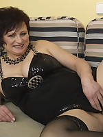 Naughty housewife playing with her toy boy
