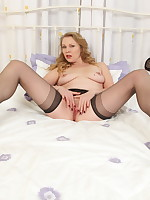 Naughty British MILF playing with her pussy