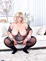 Naughty big breasted mama playing with herself