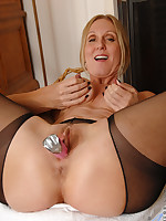 Classy milf Jenna Covelli stuffs a toy into her wet pussy
